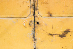 Yellow paint mottled tin Stock Photography