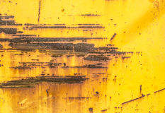 Yellow paint mottled tin Stock Image