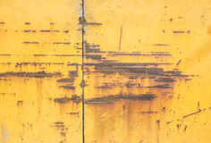 Yellow paint mottled tin. Yellow color paint mottled weathering of rust Royalty Free Stock Photo
