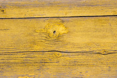 Yellow paint mottled wooden door Royalty Free Stock Photography
