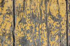 Yellow paint mottled wooden door Royalty Free Stock Image