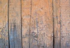 Yellow paint mottled wooden door Stock Images