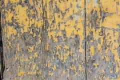 Yellow paint mottled wooden door Stock Image