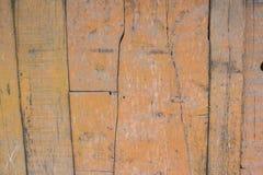 Yellow paint mottled wooden door Royalty Free Stock Photos