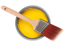 Yellow paint with paintbrush Stock Photo