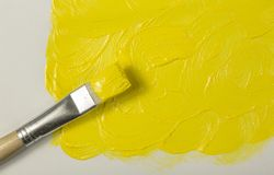 Yellow paint with paintbrush Royalty Free Stock Images