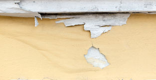 Yellow paint peeling off at concrete wall,texture background Royalty Free Stock Photo