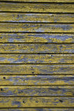 Yellow paint peeling of wood wall background Royalty Free Stock Photo