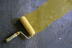 Yellow paint roller Royalty Free Stock Photo
