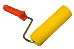 Yellow paint roller on white Royalty Free Stock Photos