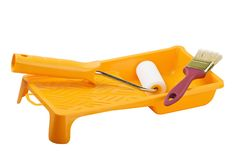 Yellow paint tray with foam roller and paintbrush Stock Image