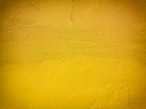 Yellow paint wall background or texture stock images