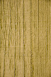 Yellow paint on wood background Stock Images