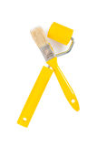 Yellow paintbrush and paintroller. Isolated on white background Stock Photography