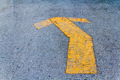 Yellow painted arrow Indication of the road Royalty Free Stock Image