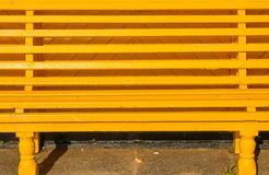 Yellow painted bench seat. Yellow painted wooden slatted bench seat on seafront promenade at Southsea, Portsmouth, Hampshire, England stock photography