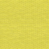 Yellow painted brick wall seamless texture Stock Photography