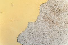 Yellow painted building and cracked hole and broken material facade. Structure Royalty Free Stock Photos