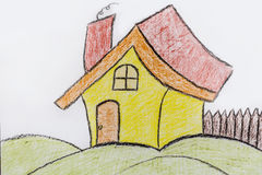 Yellow painted  children`s house .Childlike drawing of house Stock Photo