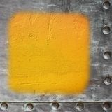 Yellow painted concrete wall blank metal frame border background Royalty Free Stock Photo