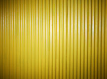 Yellow painted corrugated fence background Royalty Free Stock Photo