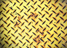 Yellow Painted Diamond Checker Steel Plate. Full frame background of yellow and black diamond checkered steel plate Stock Photos