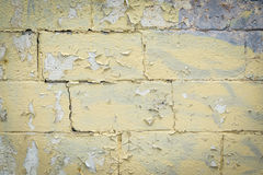 Yellow painted grunge wall texture Stock Photo