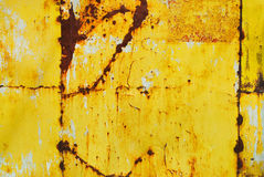 Yellow painted metal with rust texture Stock Image