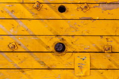 Yellow painted old wooden boards with holes. Natural wood texture. Abstract background Stock Photography