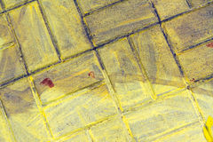 Yellow painted pavement Royalty Free Stock Image