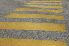 Yellow painted pedestrian traffic cross walk Stock Photos