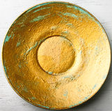 Yellow painted plate Royalty Free Stock Photos