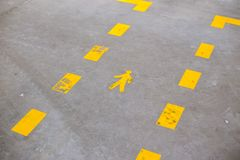 Yellow painted sign indicating pedestrian lanes stock photos