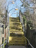 Yellow painted steps leading to station car park stock photography