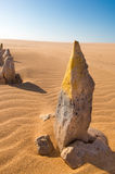 Yellow painted stone standing in the desert of La Guajira Royalty Free Stock Image