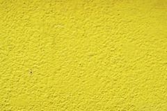 Yellow. Painted wall background in high resolution Stock Image