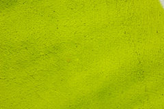 Yellow painted wall background texture Stock Images