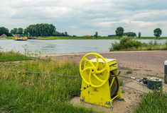 Yellow painted winch of a cable ferry Royalty Free Stock Image