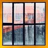 Yellow painted window frame with very dirty glass panes royalty free stock image