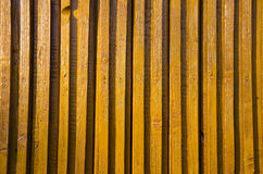 Yellow-painted wooden wall impeachment small board Stock Photos