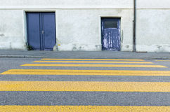Yellow painted zebra crossing for pedestrians Stock Photo
