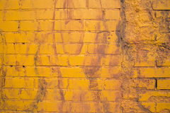 Yellow painting on brick wall Stock Photos