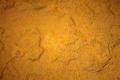 Yellow painting stone texture wallpaper Royalty Free Stock Images