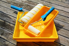 Yellow painting  tray and paint roller. Stock Photo