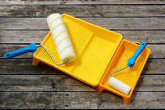 Yellow painting  tray and paint roller. Stock Photos