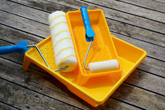 Yellow painting  tray and paint roller. Royalty Free Stock Photo