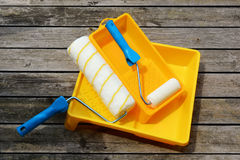 Yellow painting  tray and paint roller made. Stock Photography