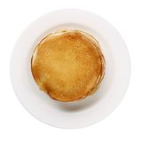 Yellow pancakes on white plate isolated Royalty Free Stock Images