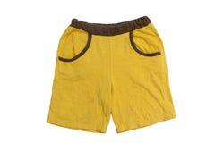 Yellow Pants Kids on white background. Royalty Free Stock Photos
