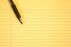 Yellow paper. Sheet of yellow lined paper Stock Photography